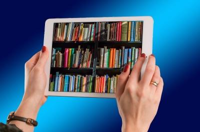 tablet books hands